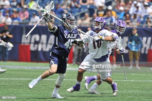 Albany Troy Reh tries to separate Yale Jason Alessi from the ball. During the Albany Great Danes game against the Yale Bulldogs at Gillette Stadium...