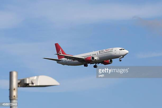 albastar passenger jet landing at gatwick airport - pejft stock pictures, royalty-free photos & images