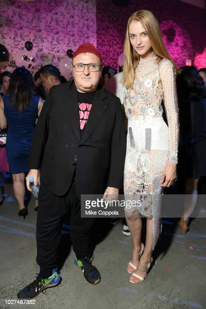 Alber Elbaz and a guest attends the Alber Elbaz X LeSportsac New York Fashion Week Party at Gallery I at Spring Studios on September 5 2018 in New...