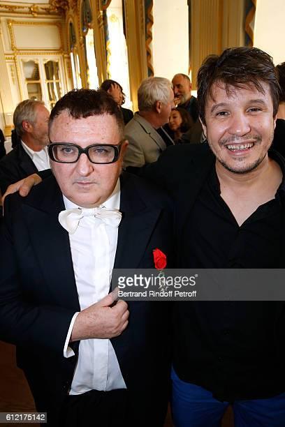 Alber Elbaz and contemporary artist Adel Abdessemed attend Alber Elbaz receives the Insigna of 'Officier de la Legion d'Honneur' at Ministere de la...