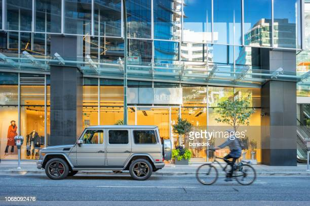 alberni street shopping street in downtown vancouver british columbia canada - mercedes benz g class stock pictures, royalty-free photos & images