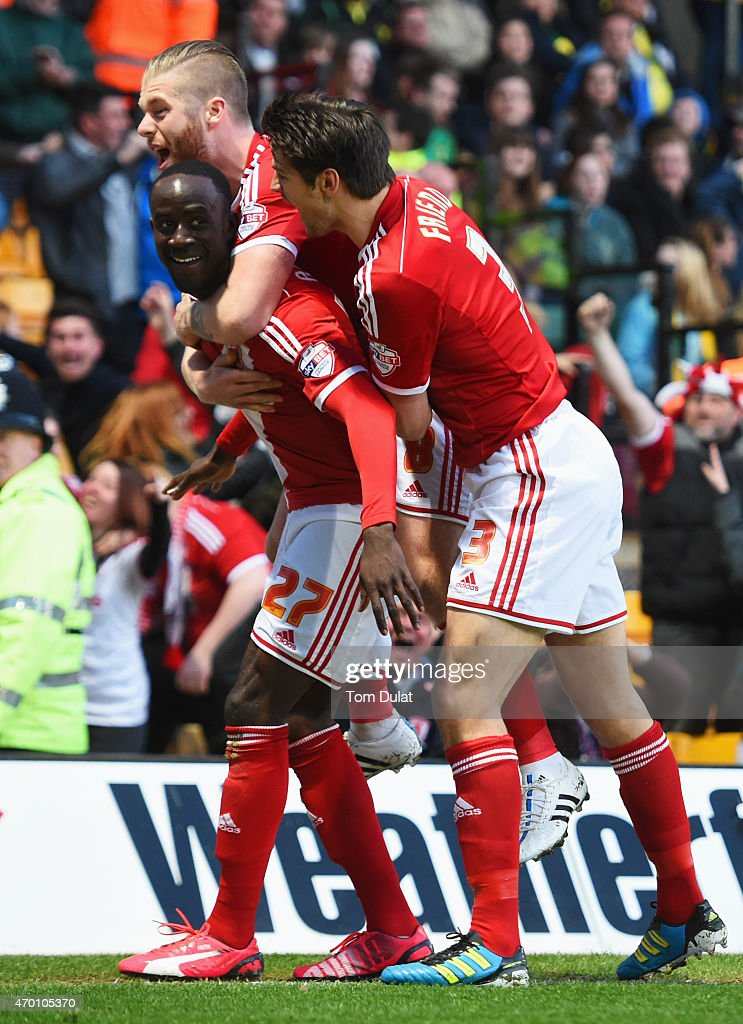 Albert Adomah (27), Adam Clayton (8) and George Friend of Middlesbrough (3) celebrate as Alexander Tettey of Norwich City scores their first goal with an own goal during the Sky Bet Championship match between Norwich City and Middlesbrough at Carrow Road on April 17, 2015 in Norwich, England.