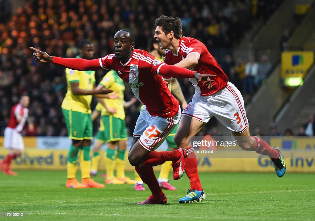 Albert Adomah (27) and George Friend of Middlesbrough (3) celebrate as Alexander Tettey of Norwich City scores their first goal with an own goal during the Sky Bet Championship match between Norwich City and Middlesbrough at Carrow Road on April 17, 2015 in Norwich, England.