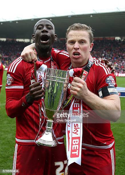 Albert Adomah and Grant Leadbitter of Middlesbrough celebrate with the trophy following the Sky Bet Championship match between Middlesbrough and...