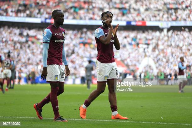 Albert Adomah and Josh Onomah of Aston Villa react following defeat during the Sky Bet Championship Play Off Final between Aston Villa and Fulham at...
