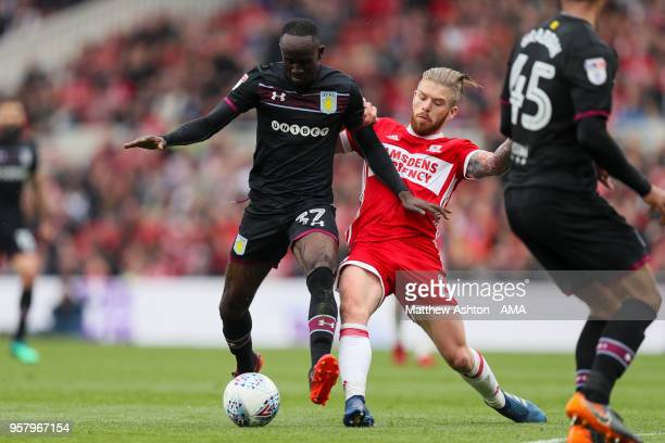 Albert Adomah of Aston Villa and Adam Clayton of Middlesbrough during the Sky Bet Championship Play Off Semi Final First Leg match between...
