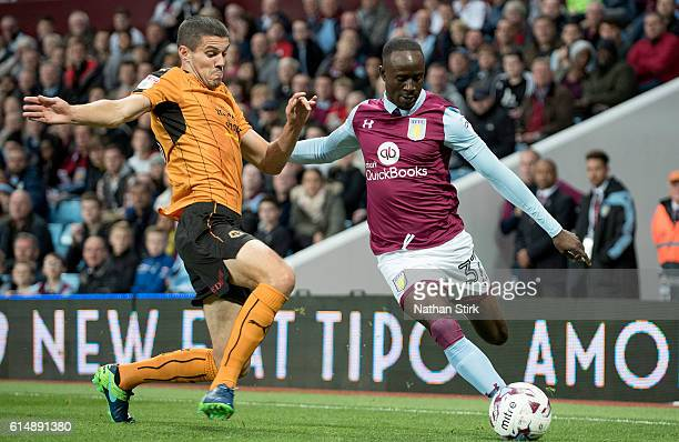 Albert Adomah of Aston Villa and Conor Coady of Wolverhampton Wanderers in action during the Sky Bet Championship match between Aston Villa and...