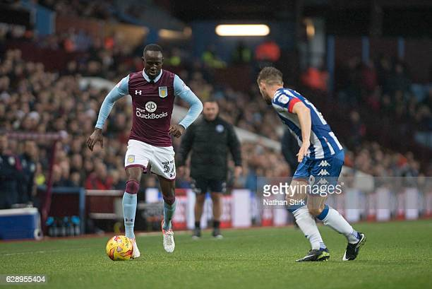 Albert Adomah of Aston Villa and Luke Garbutt of Wigan Athletic in action during the Sky Bet Championship match between Aston Villa and Wigan...