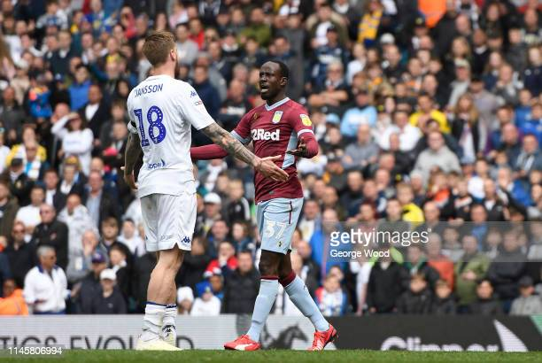 Albert Adomah of Aston Villa and Pontus Jansson of Tottenham Hotspur square up after Adomah scored equalizing goal during the Sky Bet Championship...