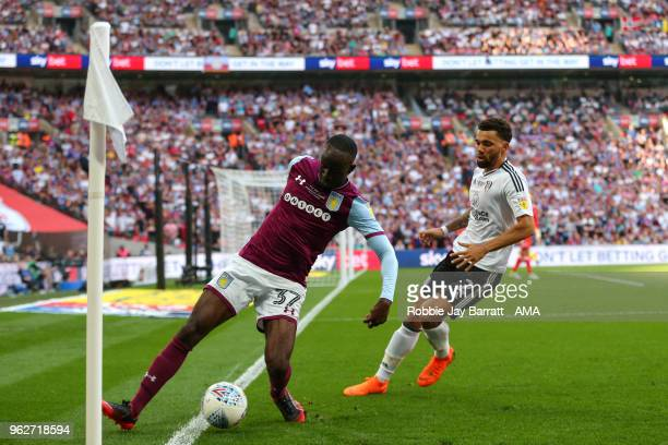 Albert Adomah of Aston Villa and Ryan Fredericks of Fulham during the Sky Bet Championship Play Off Final between Aston Villa and Fulham at Wembley...