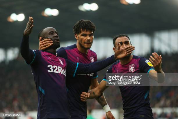 Albert Adomah of Aston Villa celebrates with team mates after scoring a goal to make it 11 during the Sky Bet Championship Match between Stoke City...