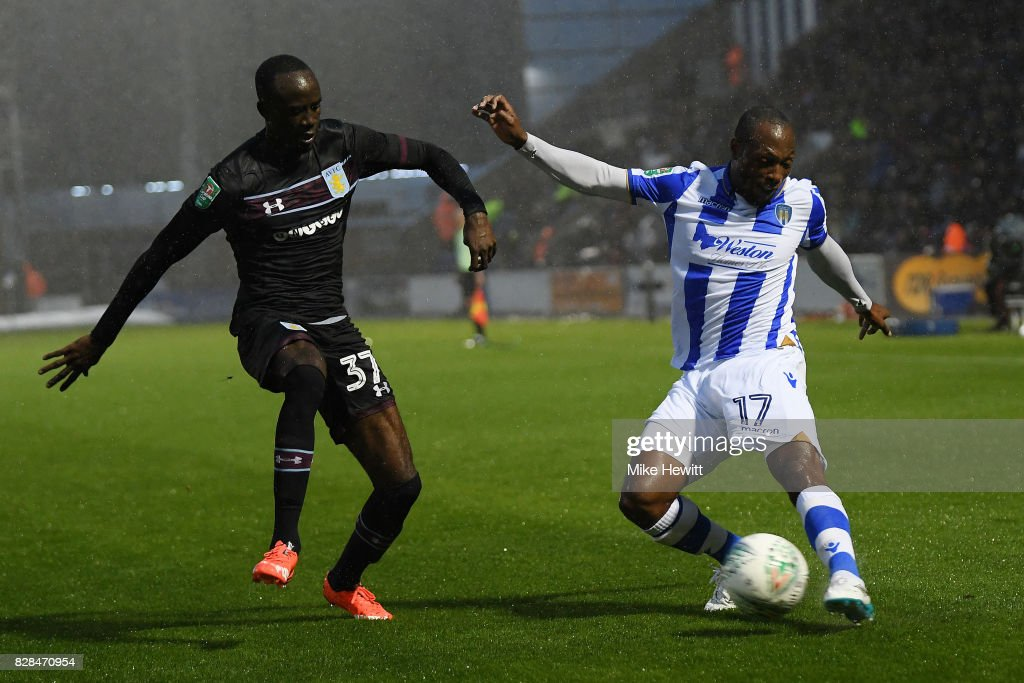 Albert Adomah of Aston Villa challenges Micah Richards of Colchester during the Carabao Cup First Round match between Colchester United and Aston Villa at Colchester Community Stadium on August 9, 2017 in Colchester, England.