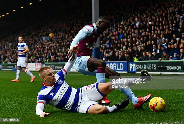 Albert Adomah of Aston Villa holds off Jake Bidwell of Queens Park Rangers during the Sky Bet Championship match between Queens Park Rangers and...