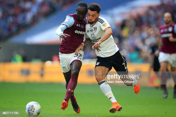 Albert Adomah of Aston Villa in action with Ryan Fredericks of Fulham during the Sky Bet Championship Play Off Final between Aston Villa and Fulham...