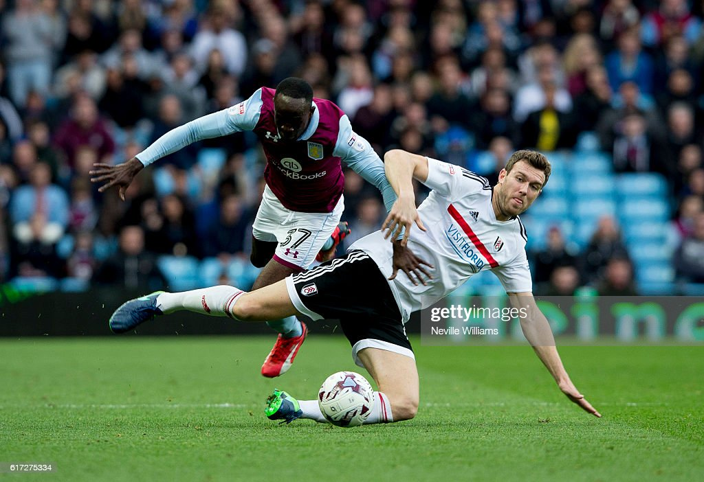 Albert Adomah of Aston Villa is challenged by Kevin McDonald of Fulham during the Sky Bet Championship match between Aston Villa and Fulham at Villa Park on October 22, 2016 in Birmingham, England.