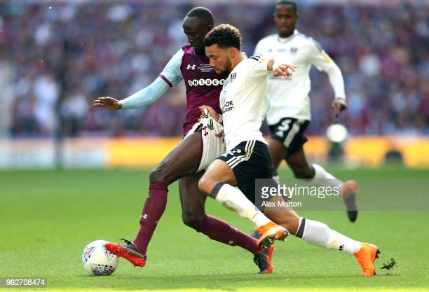 Albert Adomah of Aston Villa is challenged by Ryan Fredericks of Fulham during the Sky Bet Championship Play Off Final between Aston Villa and Fulham...