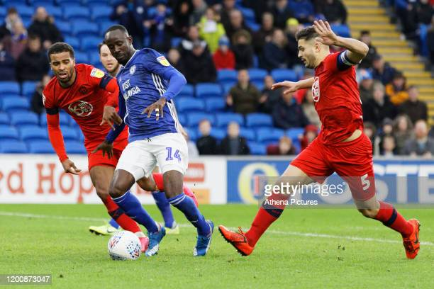 Albert Adomah of Cardiff City falls on the ground outside the box near Sam Morsy of Wigan Athletic during the Sky Bet Championship match between...