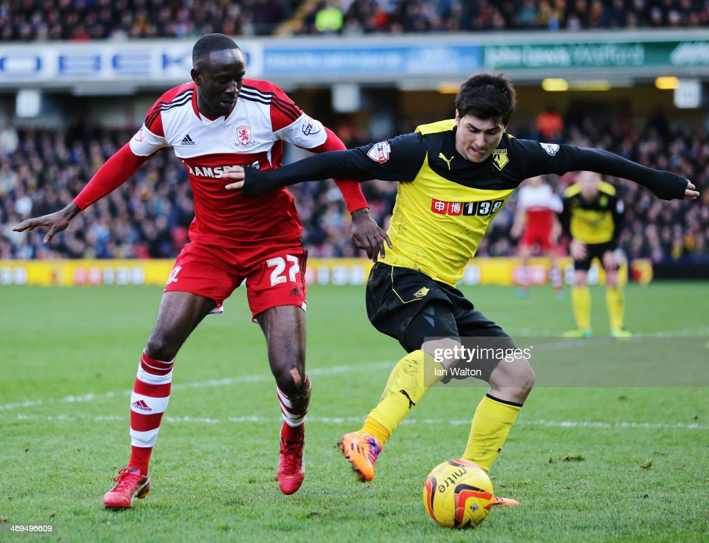 Albert Adomah of Middlesbrough and Fernando Forestieri of Watford challenge for the ball during the Sky Bet Championship match between Watford and Middlesbrough at Vicarage Road on February 15, 2014 in Watford, England.