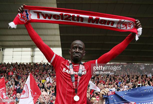 Albert Adomah of Middlesbrough celebrates his team's promotion after the Sky Bet Championship match between Middlesbrough and Brighton and Hove...