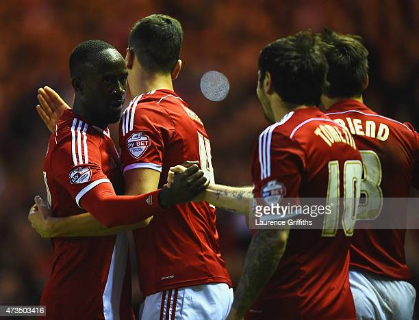 Albert Adomah of Middlesbrough celebrates with Daniel Ayala and Lee Tomlin as he scores their third goal during the Sky Bet Championship Playoff semi...