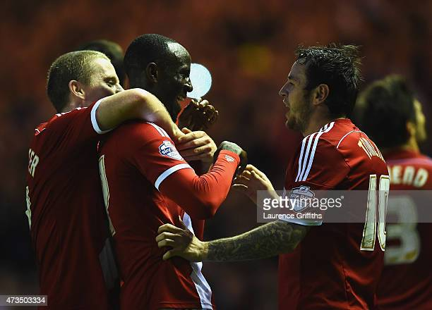 Albert Adomah of Middlesbrough celebrates with Grant Leadbitter and Lee Tomlin as he scores their third goal during the Sky Bet Championship Playoff...