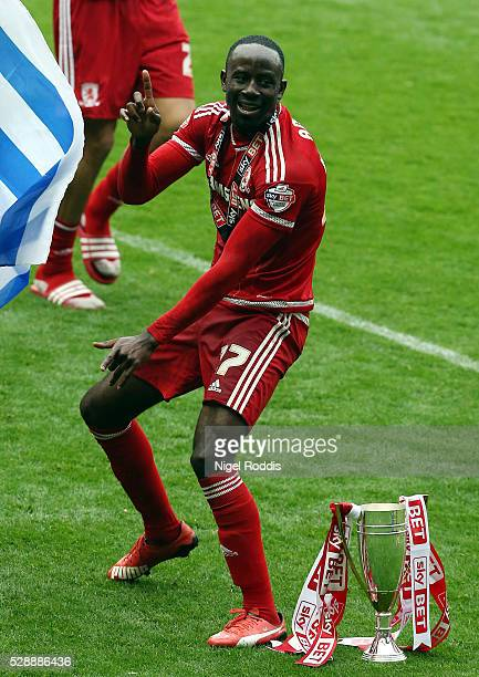 Albert Adomah of Middlesbrough celebrates with teamates and the trophy after the Sky Bet Championship match between Middlesbrough and Brighton and...