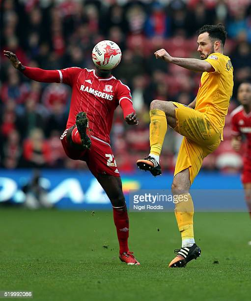 Albert Adomah of Middlesbrough is challenged by Greg Cunningham of Preston North End during the Sky Bet Championship match between Middlesbrough and...