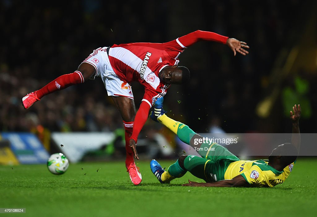 Albert Adomah of Middlesbrough is tackled by Alexander Tettey of Norwich City during the Sky Bet Championship match between Norwich City and Middlesbrough at Carrow Road on April 17, 2015 in Norwich, England.