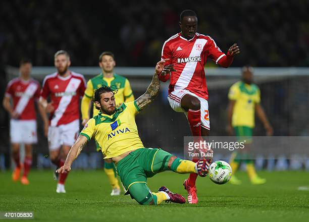 Albert Adomah of Middlesbrough is tackled by Bradley Johnson of Norwich City during the Sky Bet Championship match between Norwich City and...