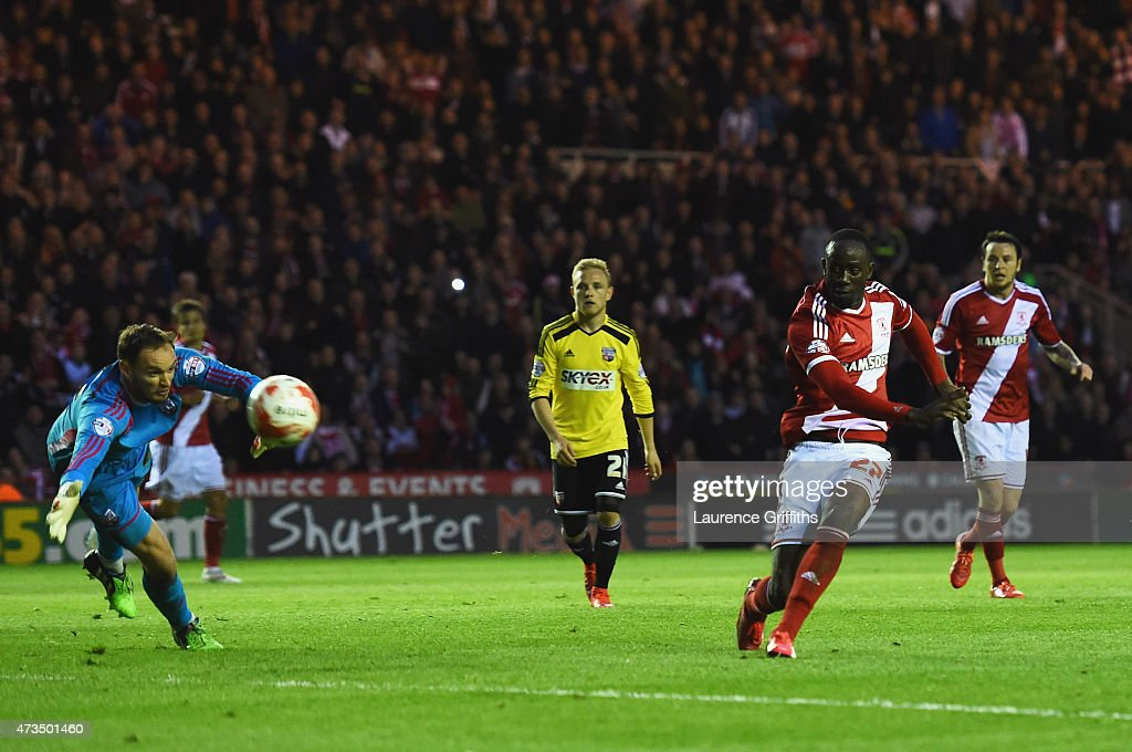 Albert Adomah of Middlesbrough shoots past goalkeeper David Button of Brentford to score their third goal during the Sky Bet Championship Playoff semi final second leg match between Middlesbrough and Brentford at the Riverside Stadium on May 15, 2015 in Middlesbrough, England.