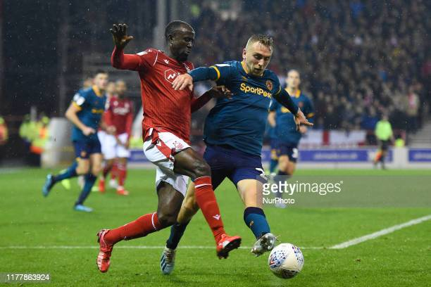 Albert Adomah of Nottingham Forest battles with Jarrod Bowen of Hull City during the Sky Bet Championship match between Nottingham Forest and Hull...