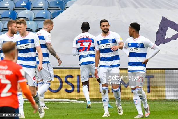 Albert Adomah of QPR celebrates after scoring his team's third goal with his team mates during the Sky Bet Championship match between Queens Park...