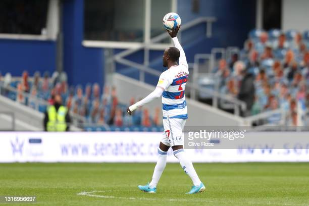 Albert Adomah of Queens Park Rangers walks off of the pitch with the match ball following the Sky Bet Championship match between Queens Park Rangers...