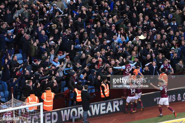 Albert Adomah of Villa celebrates in front of the fans after scoring their 1st goal during the Sky Bet Championship match between Aston Villa and...