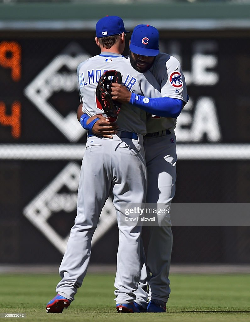 Albert Almora #5 and Jason Heyward #22 of the Chicago Cubs hug after beating the Philadelphia Phillies 8-1 at Citizens Bank Park on June 8, 2016 in Philadelphia, Pennsylvania.