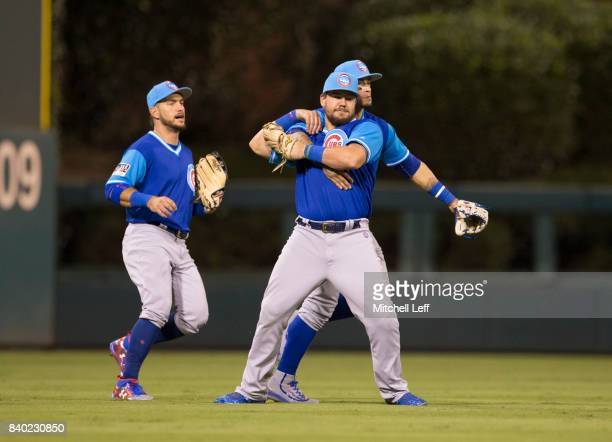 Albert Almora Jr #5 Kyle Schwarber and Javier Baez of the Chicago Cubs celebrate at the end of the game against the Philadelphia Phillies at Citizens...