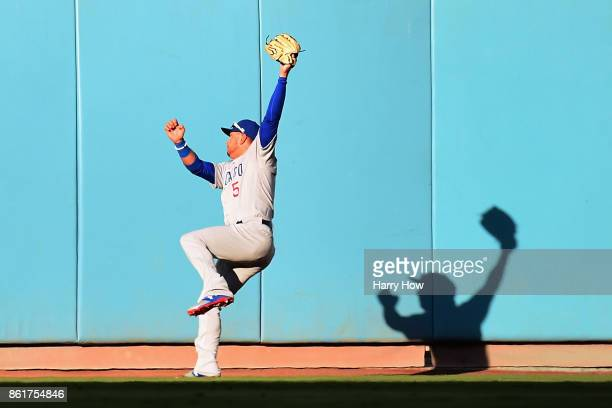 Albert Almora Jr #5 of the Chicago Cubs catches a ball hit by Justin Turner of the Los Angeles Dodgers for an out in the first inning during game two...