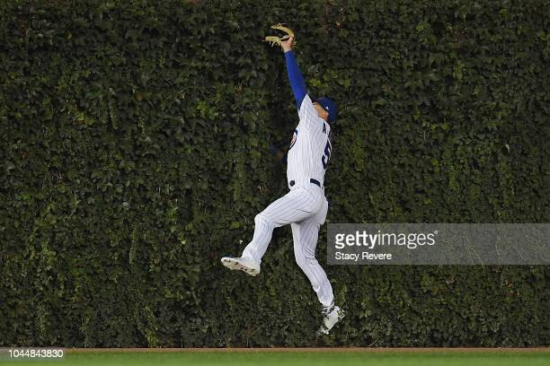 Albert Almora Jr #5 of the Chicago Cubs catches a fly ball at the wall in the second inning against the Colorado Rockies during the National League...