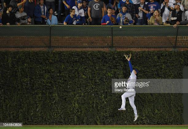 Albert Almora Jr. #5 of the Chicago Cubs catches a fly ball at the wall in the second inning against the Colorado Rockies during the National League...