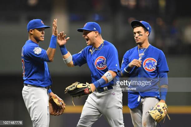 Albert Almora Jr #5 of the Chicago Cubs celebrates a victory over the Milwaukee Brewers with Addison Russell at Miller Park on September 5 2018 in...