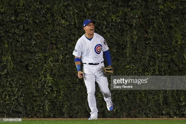 Albert Almora Jr #5 of the Chicago Cubs celebrates after catching a fly ball at the wall in the second inning against the Colorado Rockies during the...