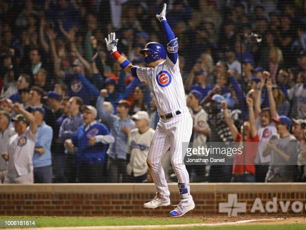 Albert Almora Jr #5 of the Chicago Cubs celebrates after getting the gamewinning hit in the 10th inning against the Los Angeles Dodgers at Wrigley...