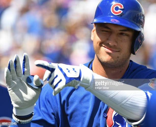 Albert Almora Jr #5 of the Chicago Cubs celebrates after hitting a threerun home run in the first inning of an exhibition game against the Cincinnati...