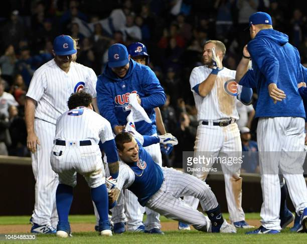 Albert Almora Jr #5 of the Chicago Cubs celebrates with his teammates after hitting a gamewinning walkoff single against the Pittsburgh Pirates...