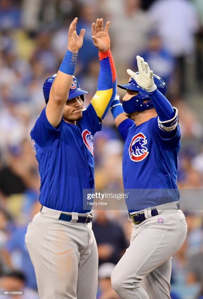 Albert Almora Jr. #5 of the Chicago Cubs celebrates with Willson Contreras #40 after scoring a two run home run against Clayton Kershaw #22 of the Los Angeles Dodgers during the fourth inning in Game One of the National League Championship Series at Dodger Stadium on October 14, 2017 in Los Angeles, California.