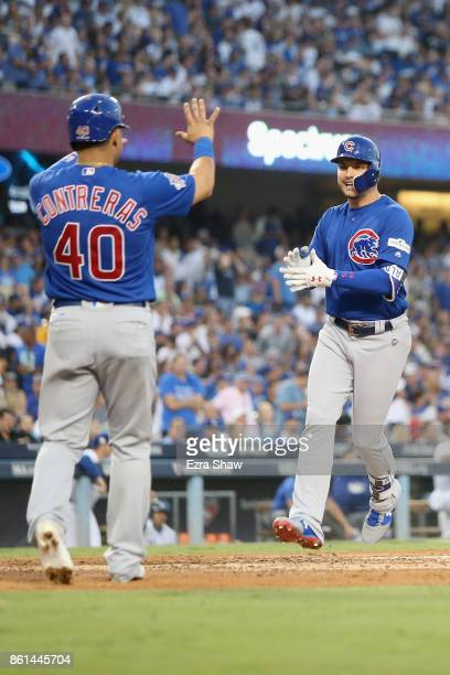 Albert Almora Jr #5 of the Chicago Cubs celebrates with Willson Contreras after scoring a two run home run against Clayton Kershaw of the Los Angeles...