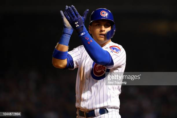 Albert Almora Jr #5 # of the Chicago Cubs claps his hands during the seventh inning in the National League Wild Card game against the Colorado...
