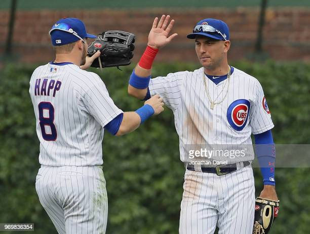 Albert Almora Jr #5 of the Chicago Cubs congratulates Ian Happ after Happ made a gameending catch in the left field against the Pittsburgh Pirates at...