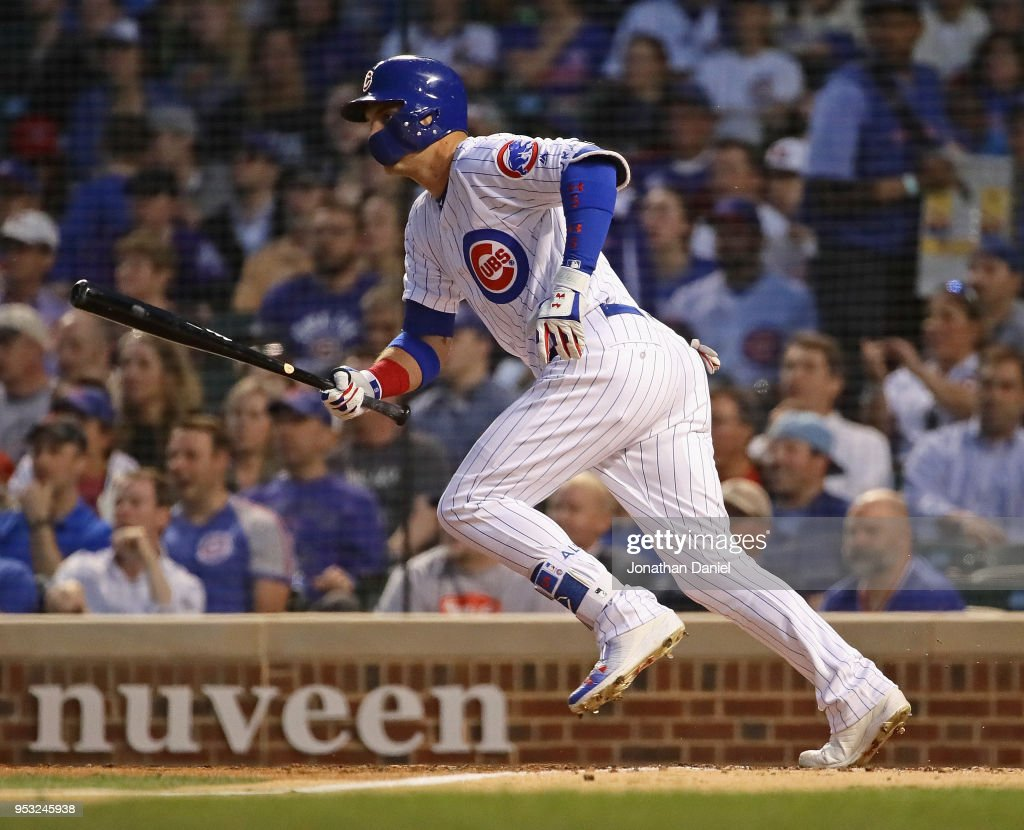 Albert Almora Jr. #5 of the Chicago Cubs hits a run scoring single in the 6th inning against the Colorado Rockies at Wrigley Field on April 30, 2018 in Chicago, Illinois.