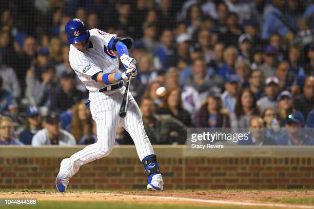 Albert Almora Jr #5 of the Chicago Cubs hits a single in the second inning against the Colorado Rockies during the National League Wild Card Game at...